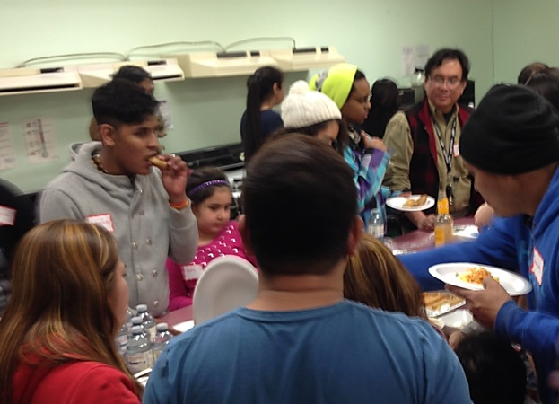 Newcomers get together and share delicious dishes